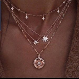 Gold tone stars pendant necklace